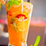 A mojito with mango, lime juice, simple sugar syrup, mint and rum