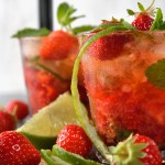 Two tall glasses strawberry mojito drink