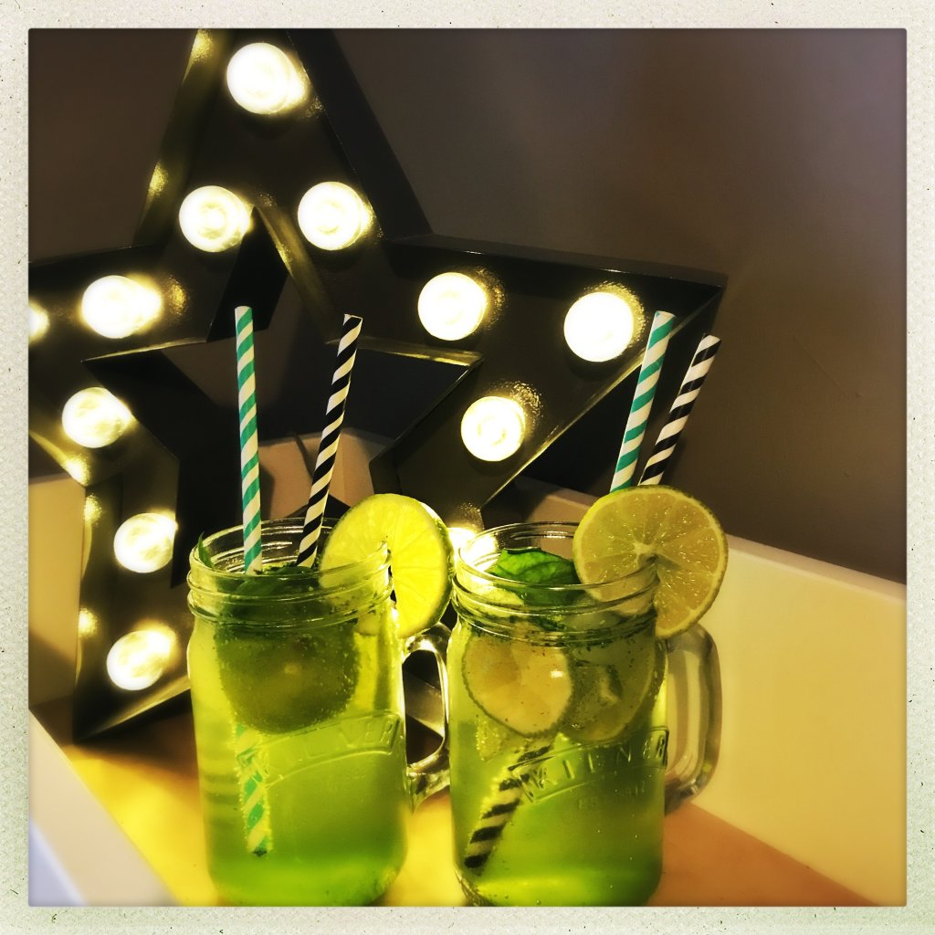 alcohol free mojitos garnished with limes and stripy paper straws