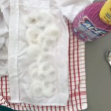 kids white school shirt with stains of mud, Nutella, jam, honey, ketchup and cranberry juice spilled down the front of it - sprayed with ACE power mousse stain remover for white laundry