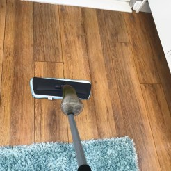 ADDIS spray mop being used to mop laminate floor