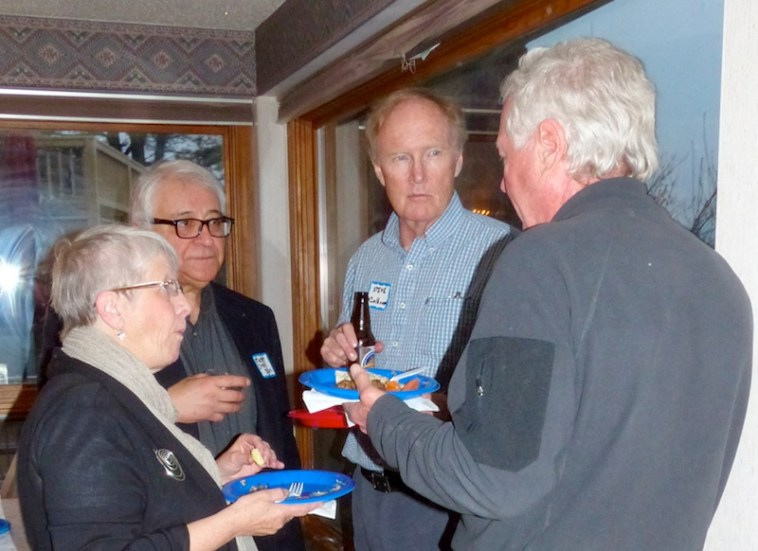 (from left) An unidentified female guest, host John Tsitrian, Steve Calhoun, and State Dems vice-chair Joe Lowe discuss politics at the SDP fundraiser, Rapid City, SD, 2015.04.08. Photo by Bob Newland.
