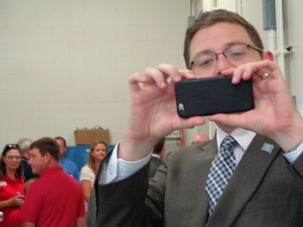 Tony Venhuizen, chief of staff for Governor Daugaard, takes a picture of some of his favorite media people.