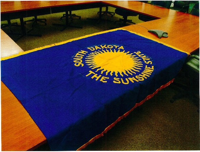 Original South Dakota state flag—obverse, commissioned 1909, stolen January 2015, recovered October 2015. Photo courtesy South Dakota Attorney General's office.