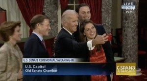 Vice-President Joe Biden snaps another selfie during Senate swearings-in. Screen cap from C-SPAN, 2017.01.03.
