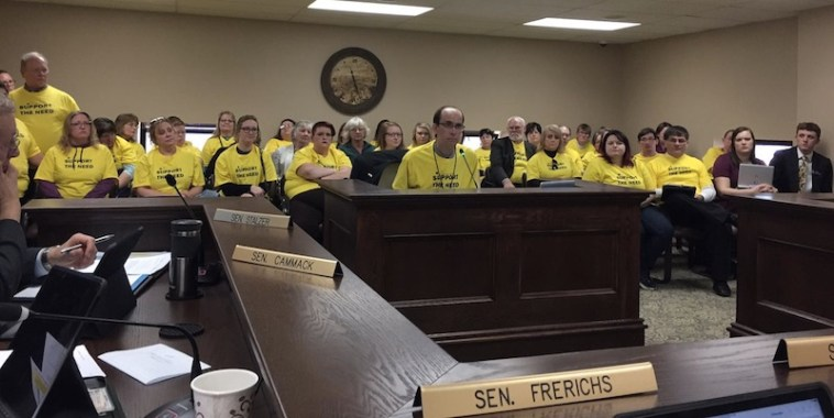 Supporters of SB 169 in yellow t-shirts (including tax-hike sponsor Sen. Al Novstrup, in yellow t-shirt at far right), Senate Taxation, 2017.02.15. Photo tweeted by Sen. Jason Frerichs.