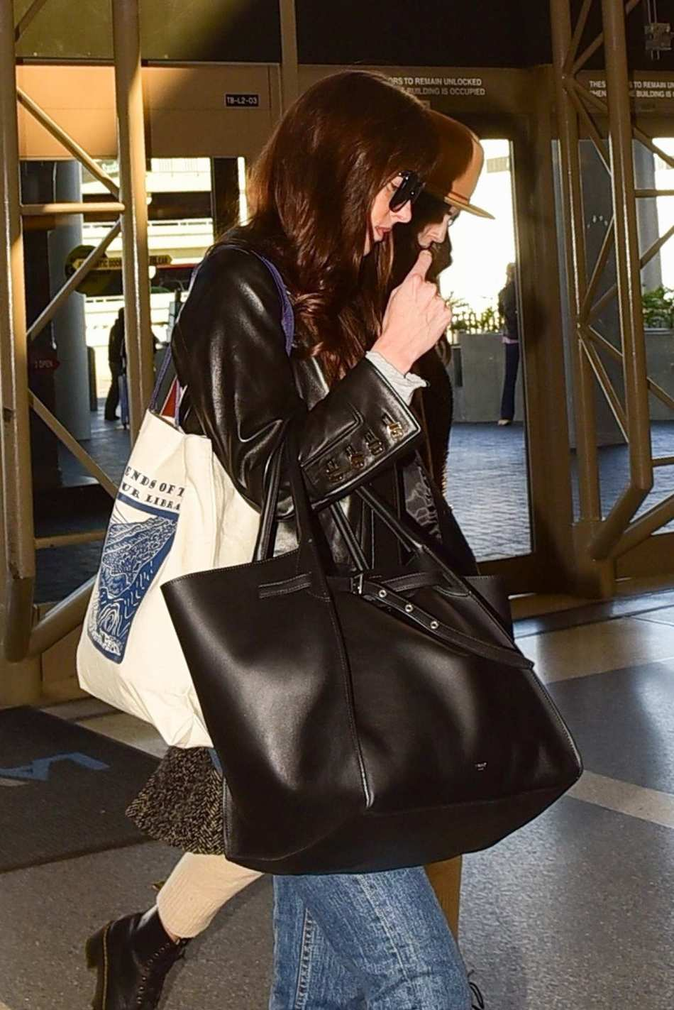 Dakota Johnson is seen at the airport to catch a flight out in LA – Feb 14th