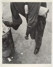 Man Resting Foot on Lip of Trashcan Leon Levinstein