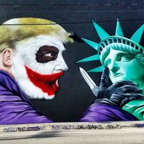 Mural by Sipros Donald Trump as Joker and Statue of Liberty