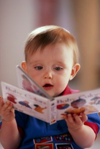 78401062-baby-playing-with-book-jupiterimages