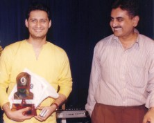 Dale Bhagwagar receives a Lions Club Award for excellence in Entertainment PR. - Pic 5.