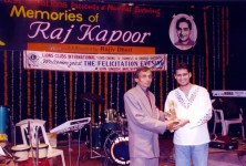 Dale Bhagwagar receives a Lions Club Award from Umesh Malviya, for excellence in Entertainment PR. - Pic 3.