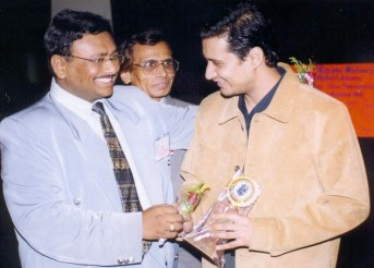 Dale Bhagwagar receives a Lions Club Award for excellence in Entertainment PR. - Pic 6.