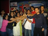 ves black 24. VES - Dale Bhagwagar handing over a trophy to the winners of a Short-Film Festival in VES College, Mumbai.