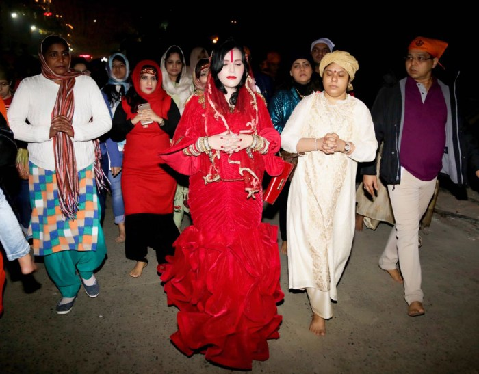 radhe-maa-in-a-red-mermaid-outfit-replete-with-a-red-purse-and-surrounded-by-devotees