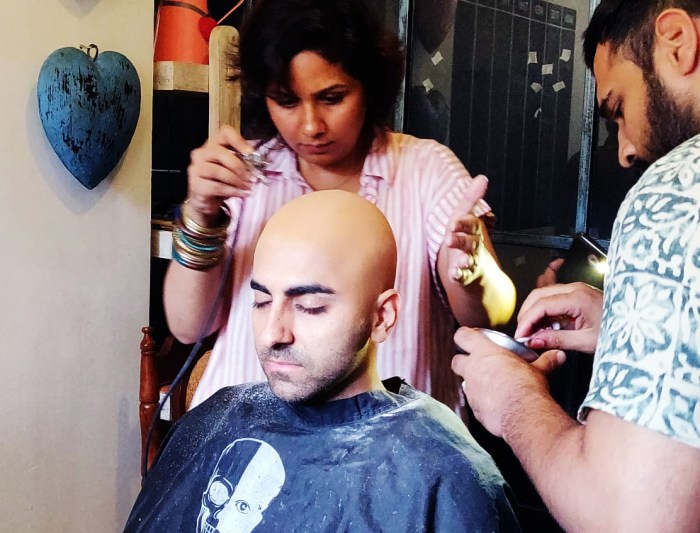 Preetisheel Singh working on Ayushmann Khurrana's look on the sets of Bala. Pic 2.