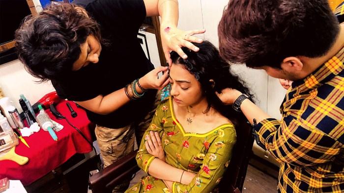 Preetisheel Singh working on Radhika Apte's look for Raat Akeli Hai. Pic 1.