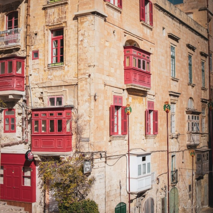 This one is not only a beautiful building covered with cute little red balconies but also a bar called Bridge bar.