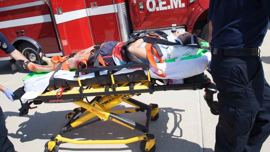 Injured victim on stretcher needing pain and suffering lawyer in Dallas