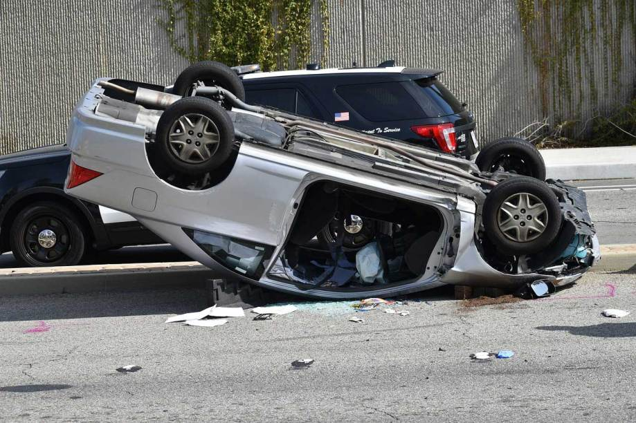 White car upside down after accident, Dallas hand injury lawyer