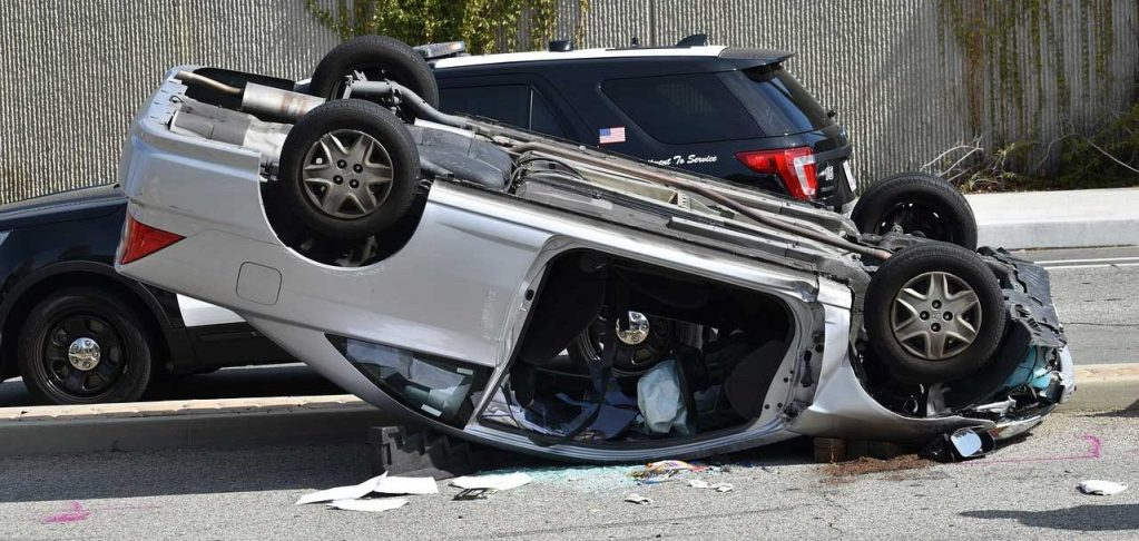 Upside down car accident scene, Dallas Reckless Driver Injury Lawyer