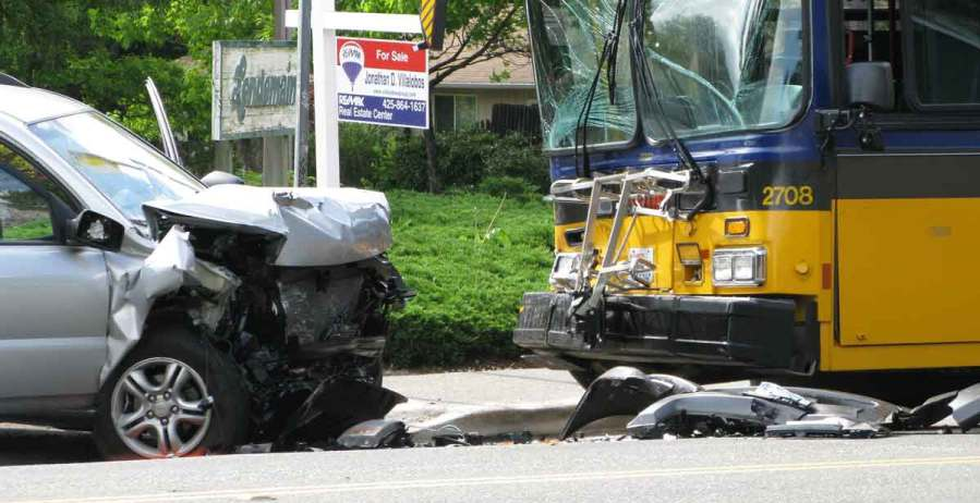 Bus and car involved in accident, City vehicle injury accidents