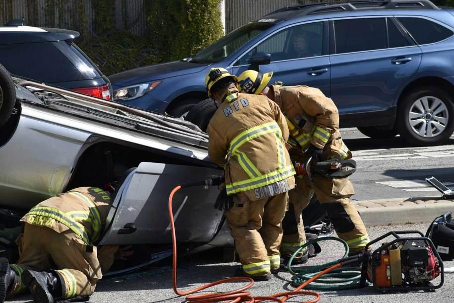 Emergency personnel rescuing accident victim, Dallas disfigurement accident lawyer