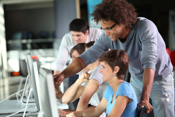 Students learning at computer