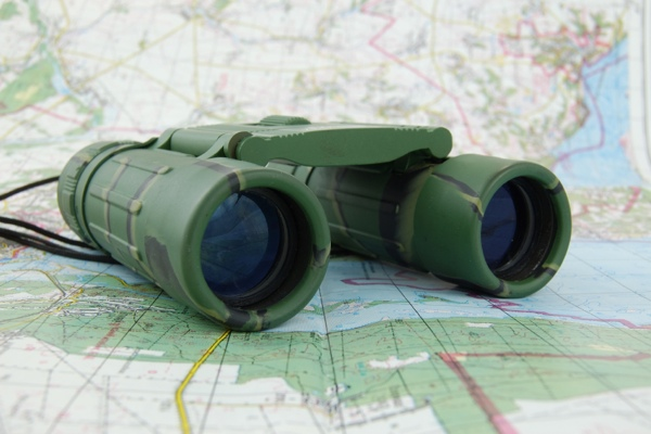 Land and Expand binoculars and map