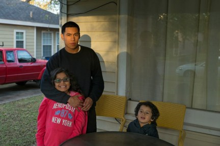 """Guillermo Araujo, first time midterm voter, and his children, Angela, 9, and Roman, 4, at their house in Oak Cliff on Thursday, Nov. 9, 2018. Araujo said he is trying to teach his children not to vote for who is popular but to """"know the candidates and vote for who best represents you.""""(Daniel Carde/Staff Photographer)"""