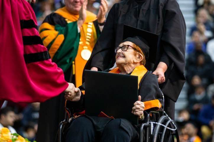Receiving her bachelor's degree diploma.