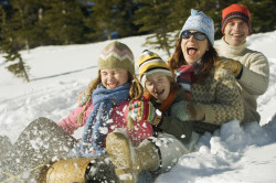 Family Sledding --- Image by © Royalty-Free/Corbis