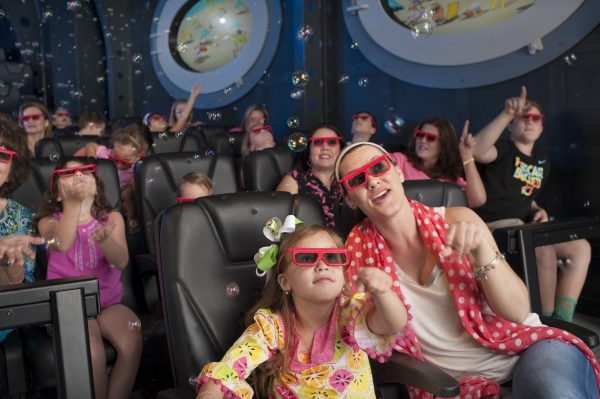 Children and parents wearing 3-D glasses reach for bubbles and 3-D objects during the Spongebob Subpants Adventure inside the Discovery Pyramid at Moody Gardens in Galveston, Texas.  In the background through the portholes can be see Goo Lagoon.