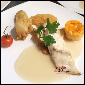 Filetto di Ombrina scottato in salsa di Vernaccia con fiori di zucca