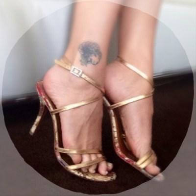 Bare feet gold sandals pedicure