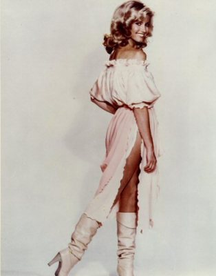 Olivia Newton John, reigning Queen of roller disco & flipped hair.