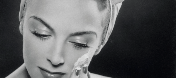 woman putting cream on face vintage image Nivea review