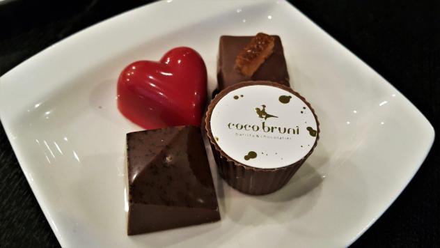 coco bruni chocolate truffles closeup raspberry bonbons