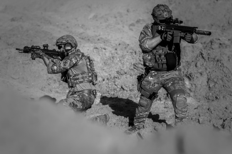 Canva - 2 Person in Army Suit Grayscale Photography