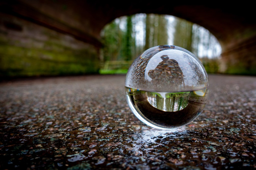 Under the bridge with a selfie in a Lensball.