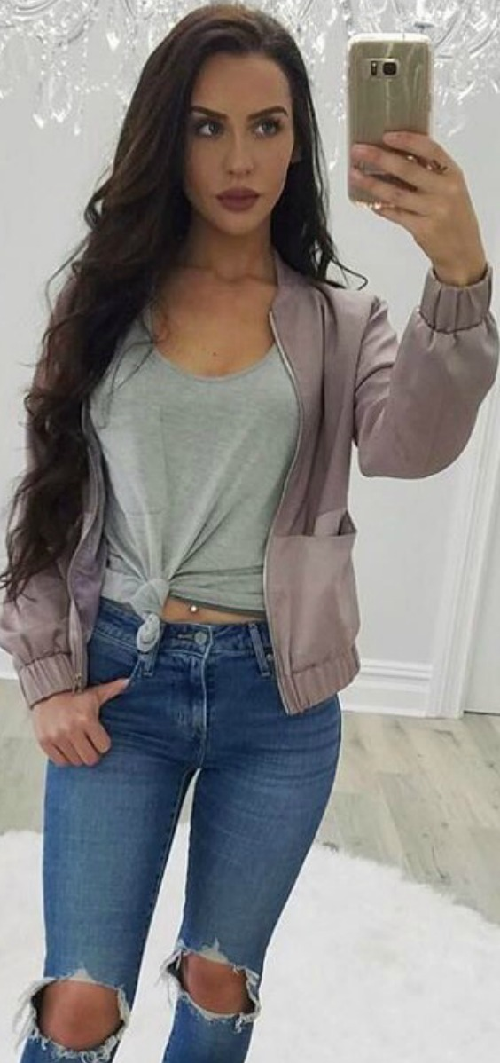 mauve-bomber-jacket-ripped-blue-jeans