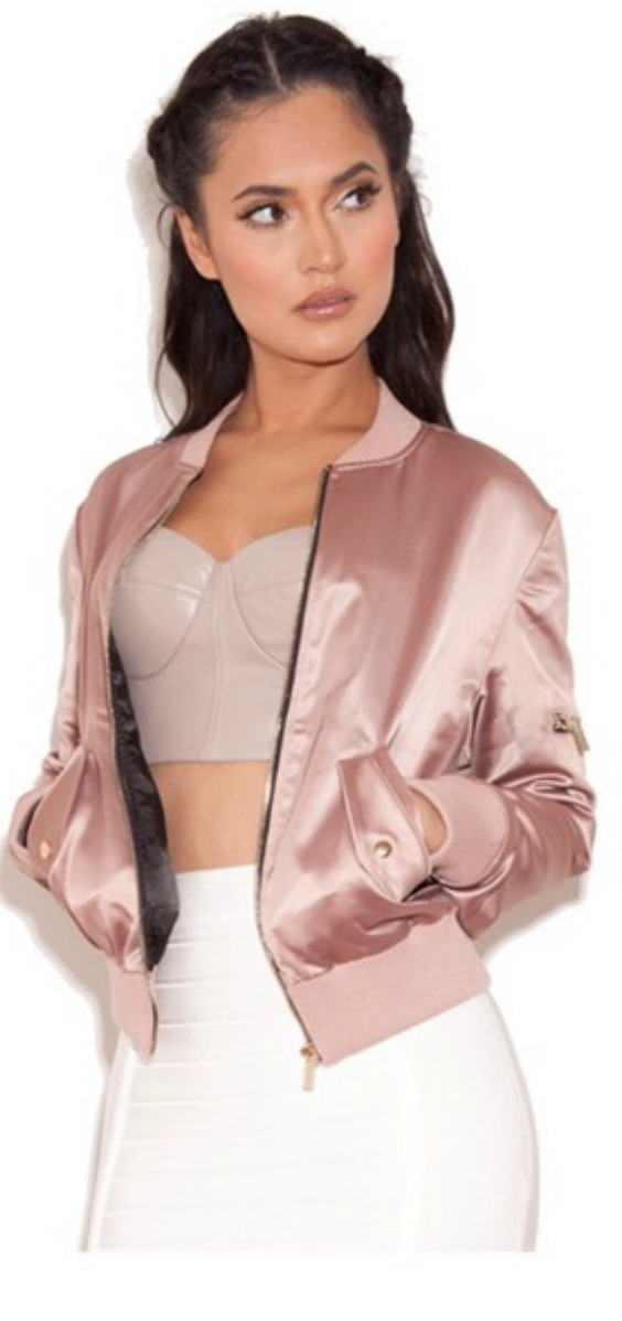 a women wearing a pink satin bomber jacket with a white jeans outfit idea