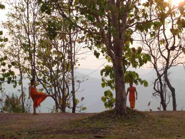 Two monks having a kick