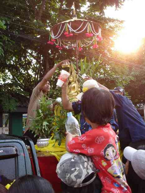 Cleansing the Lord Buddha with a 'Big Gulp' cup from 7-11