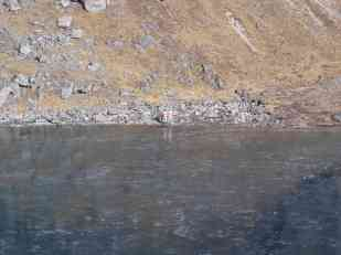 Two Israeli guys taking photos of themselves naked at a fozen lake thinking they are all alone