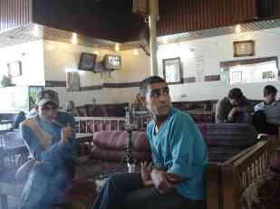 Smoking shisha and watching football in an Iranian tea house.