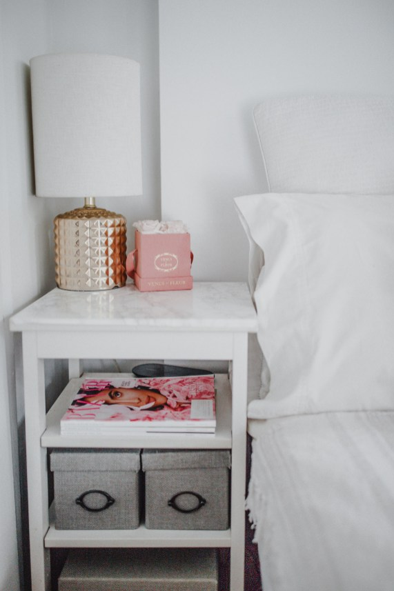 NYC apartment decor ideas. Designing small spaces new york city bedroom. White bedroom decor end table vignette