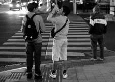 Two teenagers waited the crossing light to turn green, Naha City