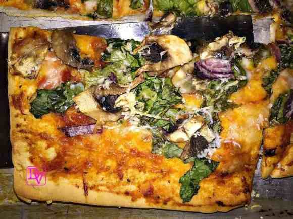 Veggie-Pizza-With-Dandelion-Greens-Corner-cut