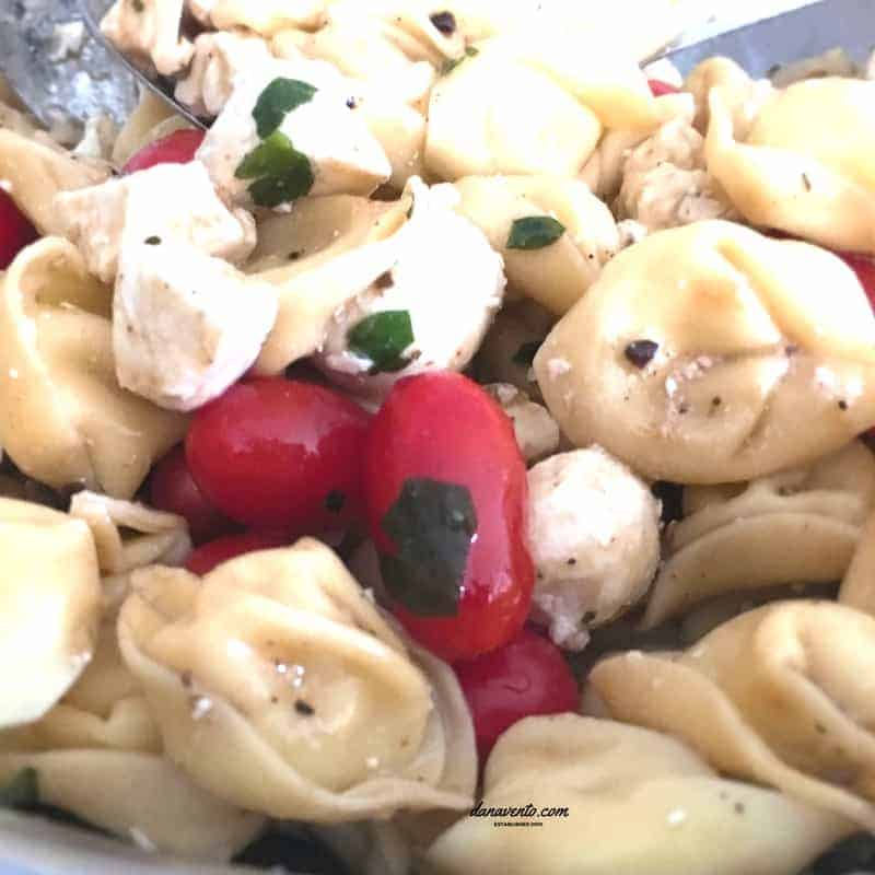 Tortellini Caprese Salad, Fresh Mozarella, Balsamic, Balsamic Dressing, Tomatoes, Cherry Tomatoes, Grape Tomatoes, Feta Cheese, Cheese Tortellini, Food, easy to prepare. Cooking, food, homemade, artisan, food prepared, prepared at home, how to, food diy, recipe, food recipe, food instructions, how to cook, food prep, greens, meatless, meat, food post, recipe post, diy post, kitchen, hands on, yummy, delicious, green and mean, fabulous food, easy to prepare, at home preparation, food prep in your home, you are the chef, go you, cooking recipes, edible, good eats, yummy, instant food, instant good, meals at home, dinner, lunch, side dishes, picnics, parties, picnics, holidays, seasonal, basil, orgeno, spices, good eats, fast to make, large parties, al fresco dining, dining in, dining out, patio dining, catering pan, recipe, cooking recipe, recipes, food recipe, easy to make recipe
